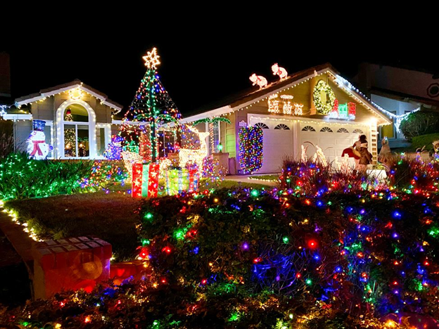 Exterior of a home covered in Christmas lights.
